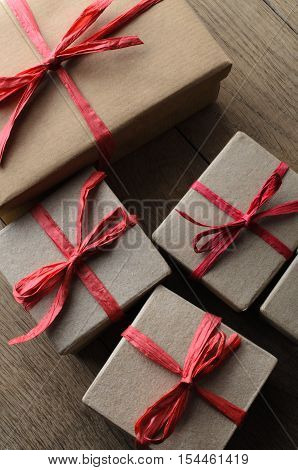 Overhead Of Gift Boxes Tied With Red Ribbon On Wood