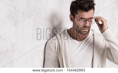 Handsome fashionable man posing in studio. Attractive man.