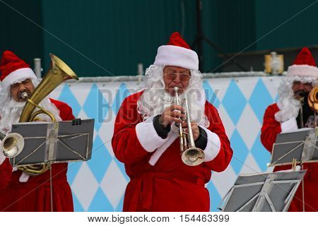 Moscow Russia - January 03 2013: Santa Claus band performs Christmas carols in Park Gorkogo in Moscow.
