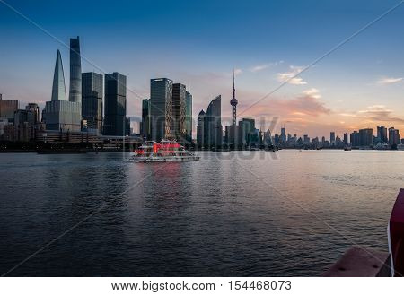 SHANGHAI CHINA - AUGUST 29 2016: Twilight view of Shanghai skyline and the Huangpu river against Pudong District Shanghai China on August 29 2016.
