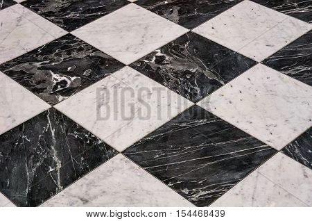 A checkerboard pattern on a stone floor.