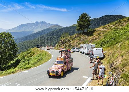 Col D'AspinFrance- July 15 2015: Cochonou Caravan during the passing of the Publicity Caravan on the Col d'Aspin in Pyerenees Mountains in the stage 11 of Le Tour de France 2015.Cochonou is an important French brand of short dry sausages.