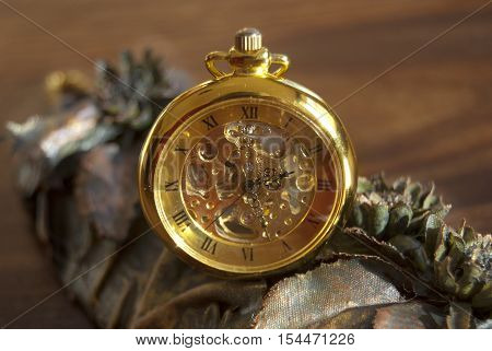 detail of an old pocket watch gold color