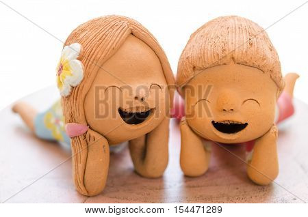 2 Smiling boy and girl clay dolls Happiness concept.