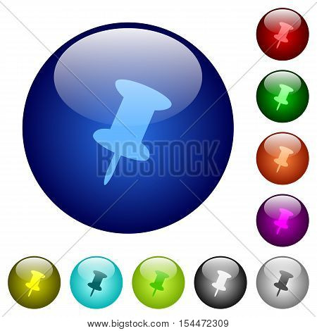 Push pin icons on round color glass buttons