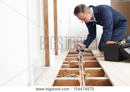 Plumber Fitting Central Heating System In House