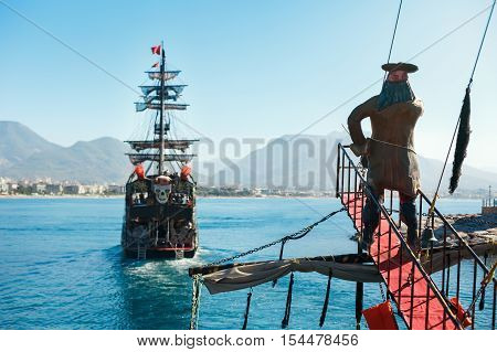 Walking tour on a pirate ship in the open sea in Alanya. Large three-deck ship.