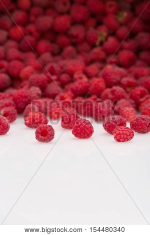 fresh organic raspberries. Summer berries dessert and snacks cattered on white background. Healthy food and summer concept