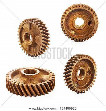 Four old rusty cog gear wheel collection isolated on white background