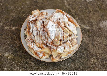 Homemade cookies in powdered sugar called Brushwood.