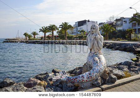 Istanbul Turkey - October 30 2016: Mermaid statue on the island of Buyukada One of the Prince Islands. by Painter Sculptors Feryal Taneri Mermaid statue made in 2014.