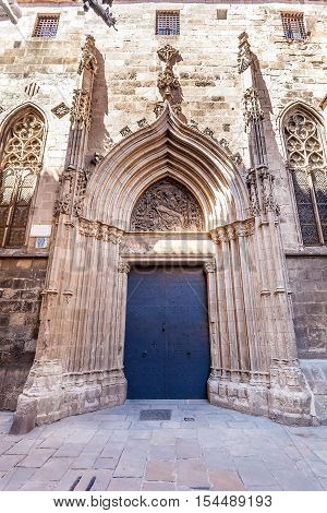 Fragment of Cathedral of the Holy Cross and Saint Eulalia in Barcelona, Spain. Detail of the entrance door.