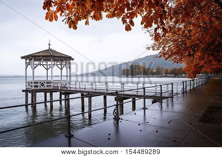 Wooden Pavilion At The Pier, Autumnal Scenery Lake Constance, Germany