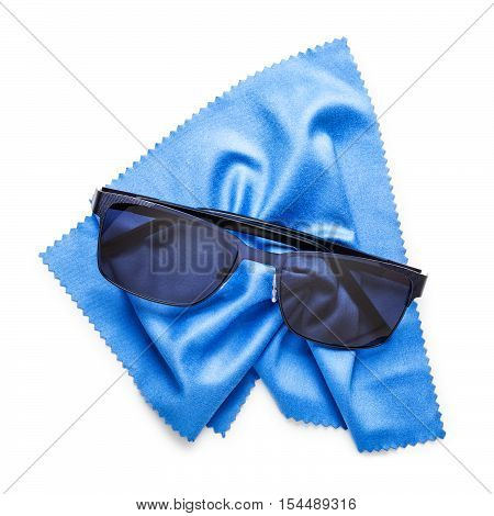 Black sunglasses and blue microfiber cleaning cloth isolated on white background. Clipping path included