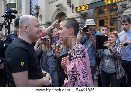 Kiev Ukraine - June 12 2016: A participant of the gay parade and the enemy of its holding in public debate