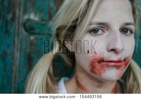 Close up serial killer or zombie woman portrait