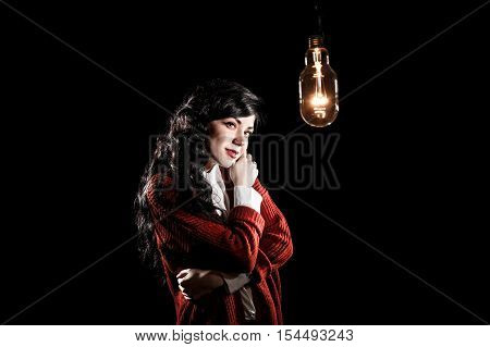 Woman Looking To The Light Bulb