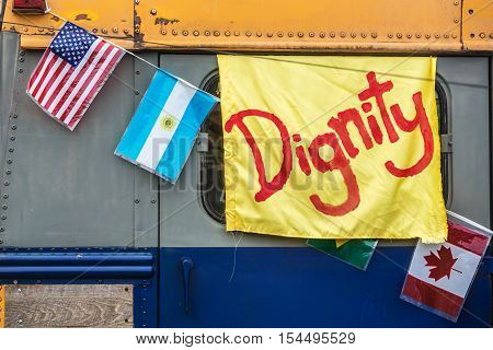 Yellow Dignity Banner On Old Bus