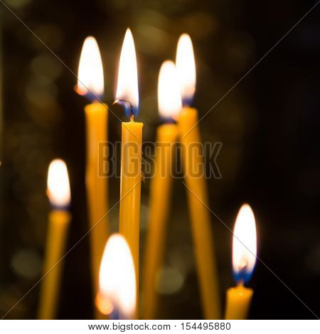 Light of candles in the church with dark background