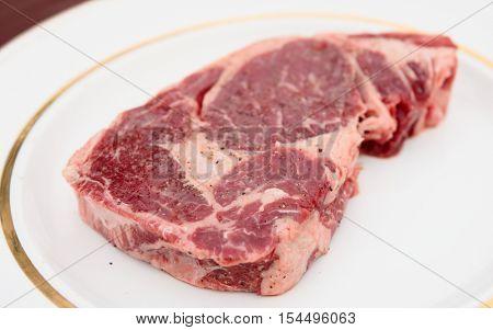 Rib eye steak in a rustic plate, close-up