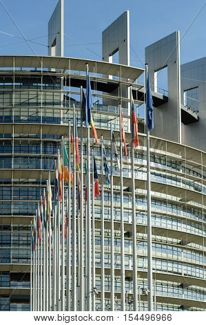 STRASBOURG, FRANCE - CIRCA 2016: All members European Union flags in front of European Parliament building front view