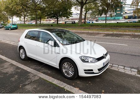 STRASBOURG FRANCE - OCT 24 2016: White Volkswagen Golf car parked on city street - The Volkswagen Golf or Volkswagen Golf GTI is a small family car produced by the German manufacturer Volkswagen since 1974