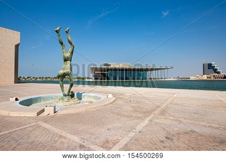 MANAMA, BAHRAIN - OCT 29, 2016: Beautiful view of the Pearl Diver monument in the Bahrain National Museum along with the Bahrain National Theater in the background