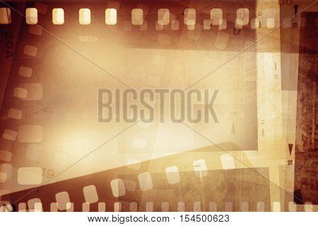 Film negative frames on orange background