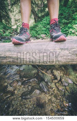 girl hiking boots on woof bridge, toned like Instagram filter