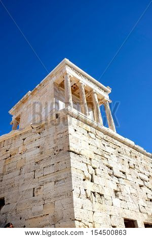 view from below of the temple of Nike at the Acropolis iAthens Greece