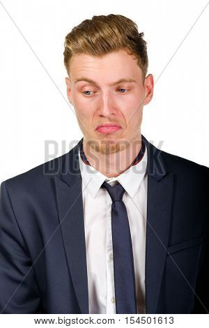 Disgusted young business man wearing suit isolated on white portrait