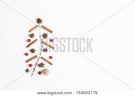 Christmas tree made of cinnamon sticks anise star larch branches cranberries. Christmas concept. Flat lay top view