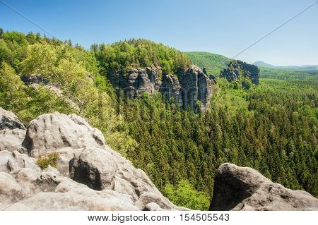 Sandstone rocks forests and blue sky in the Czech Switzerland