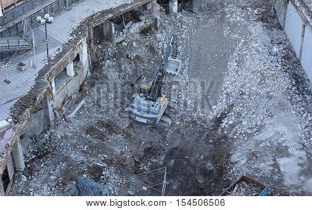 STOCKHOLM SWEDEN - OCT 30 2016: An excavator tear down the fameous area Slussen in central Stockholm preparing for the new buildings in October 30 2016 in Stockholm Sweden