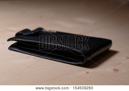 Black men's wallet on the table close-up