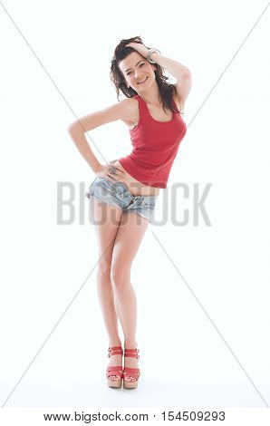 Beautiful young female at provocative posing in shorts