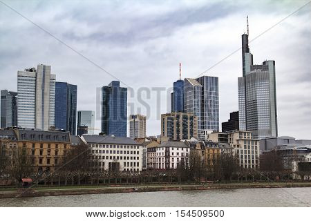 Cityscape with old buildings along the river Main and modern high bussiness centres of Frankfurt
