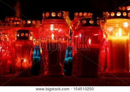 burning candles on cemetery during All Saints Day