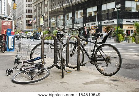 NEW YORK - SEPT 30: Chained bicycles near Broadway Ave. in a typical Manhattan scene on September 30, 2013 in New York, USA.