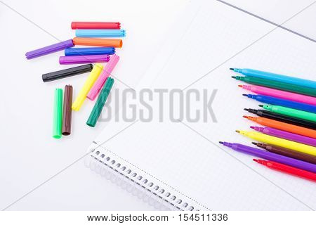Colorful felt-tip pens placed on a notebook