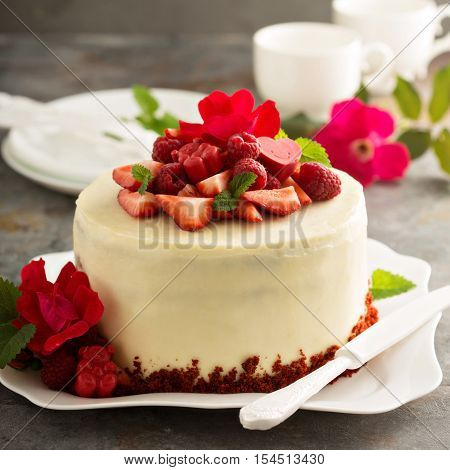 Red velvet cake decorated with strawberry and roses