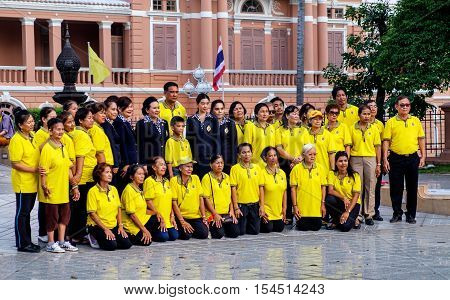 Bangkok, Thailand - December 5, 2015: Group of people wearing shirt in King's color yellow pose for a photo on Celebrating of the King Rama 9 birthday. Bangkok Thailand.