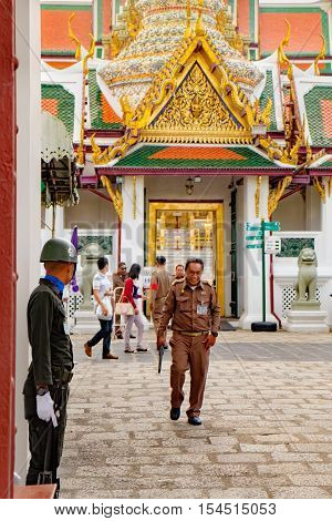 Bangkok, Thailand - December 7, 2015: The sentry with a rifle protects the main gate of Grand Palace in Bangkok - complex of buildings at the heart of Bangkok for official events and royal ceremonies