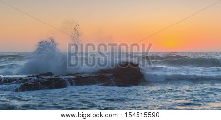 Waves breaking on a background of sea sunset. Sagres Costa Vicentina.