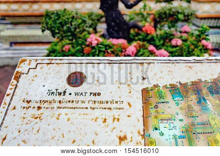 Bangkok, Thailand - December 7, 2015: Vintage sign with old map located on the territory of Wat Pho public temple Bangkok Thailand.