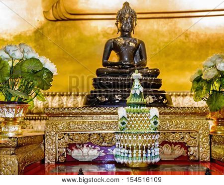 Bangkok, Thailand - December 7, 2015: Decoration in front of the statue Big Golden Buddha image inside the hall of Wat Pho public temple Bangkok Thailand.