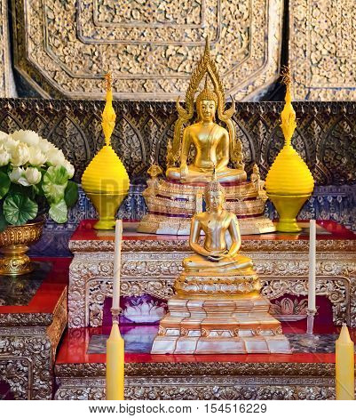 Bangkok, Thailand - December 7, 2015: Many gold Buddhas in front of the statue Big Golden Buddha image inside the hall of Wat Pho public temple Bangkok Thailand.
