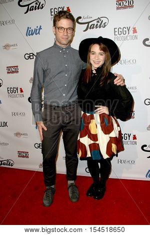 Barrett Foa and Renee Felice Smith arrive at the
