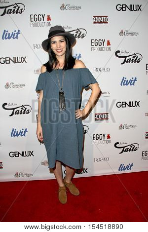 Christy Carlson Romano arrives at the
