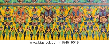Bangkok, Thailand - December 5, 2015: Traditional thailand pattern in Wat Pho Bangkok Thailand. Background with stylized natural forms.